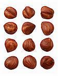 Twelve hazelnuts on a wooden surface
