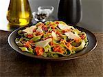 tagliatelle verdi pasta with calabrese pesto and parmesan cheese shavings