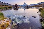 The Matterhorn reflected in Lake Stellisee at dawn, Zermatt, Canton of Valais, Pennine Alps, Swiss Alps, Switzerland, Europe