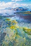 High angle view of coast and sulphur smoke at Gran Cratere, Vulcano Island, Aeolian Islands, Sicily, Italy