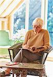 Senior woman coloring in coloring book