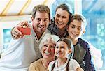 Multi-generation family taking selfie
