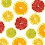 Citrus fruit slices against a white background.