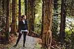 Fit brunette taking a break in the woods