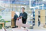 Portrait of worker on motorhome production line