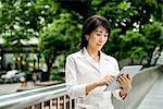Asian business woman using digital tablet
