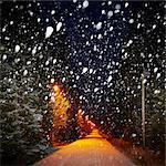 Illuminated road at winter