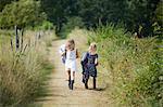 Girls walking on dirt road