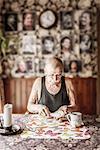 Senior man eating breakfast