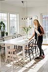 Woman setting table