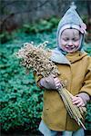A girl holing a corn sheaf
