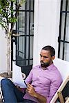 Businessman reading paperwork