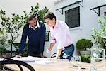 Businessmen discussing blueprint