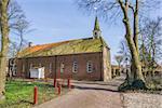 Old church in a street in Oudeschans, Holland
