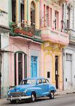 Old american car on El Malecon of Havana