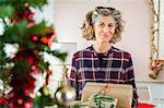 Mature woman holding Christmas presents