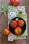 An arrangement of fresh garden tomatoes