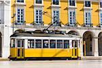 Old tram in Praca do Comercio, Baixa District, Lisbon, Portugal