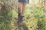 Legs of teenage girl walking in meadow