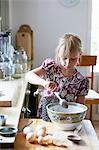 Girl mixing flour