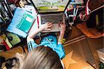 Boy playing games on laptop