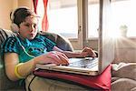 Boy using laptop at home