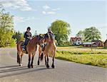 Teenage girls riding horse