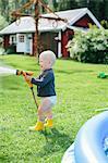 Boy with garden hose