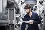 Young male engineer working in an industrial plant, Freiburg im Breisgau, Baden-Württemberg, Germany
