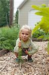 Girl holds harvested carrot
