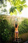 Woman standing in outdoor shower