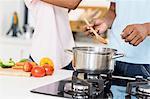 Man preparing a meal in kitchen