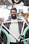 Bike mechanic lifting a bike