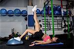 Woman exercising with bosu ball