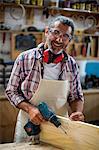 Portrait of carpenter with drill machine