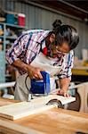 Carpenter using a jigsaw