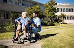 Nurse pushing the senior womans wheelchair