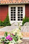 Flowers on table in backyard