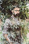 Man superimposed onto bush