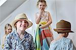 Children playing dress-up in loft room