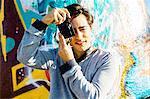 Young man using digital camera
