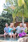 Group of seniors enjoying pool