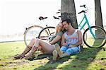 Cycling couple taking a break at Venice Beach, Los Angeles, California, USA