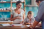 Proud parents watch daughter color coloring book