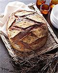 Overhead view of sourdough bread on wicker tray