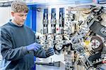 Apprentice measuring spring in automotive parts factory