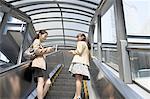 Business people walking steps outdoors