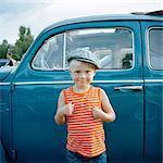 Portrait of smiling boy against vintage car
