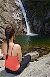 Woman admiring waterfall