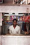 Smiling man working in kiosk